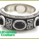 Ladies bracelet flaunts a silverskin cultivated finish with black acrylic and epoxy.