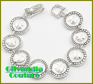 The silvertone finish and hammered Heart theme will bring this boutique bracelet to life.