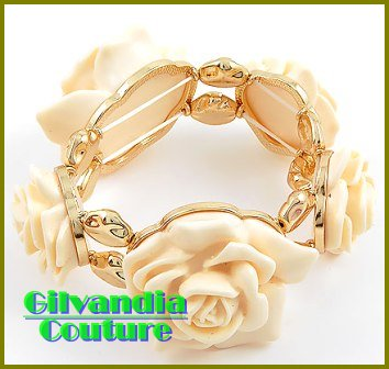 Add a luxury look to your ensemble with this smooth white floral fashion bracelet.