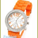 Women's celebrity runway ice accent stones, juicy orange rubber band fashion watch on sale.