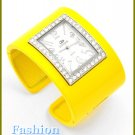 Women's celebrity runway bright yellow, ice gemstones metal cuff fashion watch on sale.