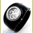 Women's celebrity runway black acrylic bangle, fabulous fashion watch on sale.