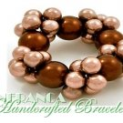 JONFRANCA celebrity runway design, bronze grand pearl cluster fashion bracelet.