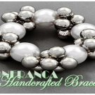 JONFRANCA celebrity runway design, silver and white grand pearl cluster fashion bracelet.