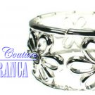 Silvertone flower stretch fashion bracelet with free complimentary gifts by JONFRANCA.