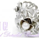 Detailed, fashion bracelet with acrylic pearls and fantastic silvertone finish.