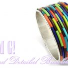 Fashion bracelet that showcases colorful acrylic bands, metalwork, with a silvermode finish.