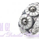 Couture,costume bracelet offers you fine epoxy, openwork lining with silver finish.