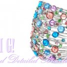 Costume bracelet dazzles with an array of colorful ice rhinestones. Designer jewelry.