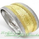 A fashion bracelet with highly polishing and two-tone hammered metalwork by JONFRANCA.