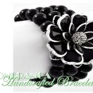 JONFRANCA fashion bracelet featuring jet black Paramount® acrylic flowers and pearls.
