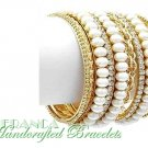 Stackable with 10 rows of satin cream pearls and metalwork.  JONFRANCA fashion bracelet.