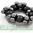 JONFRANCA Fine fashion bracelet. Stretch cluster pearls insmoke and grey shades.