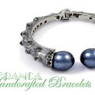 JONFRANCA Fine fashion bracelet. Grand pearls and ice rhinestone accents with grey swirls.