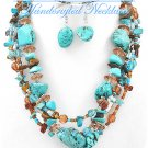 JONFRANCA CIAGA's fashion necklace with multi strands of teal gemstones and brown glass.