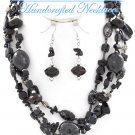 JONFRANCA CIAGA's fashion necklace with multi strands of black ceramic beads and shells.