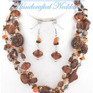 JONFRANCA CIAGA's fashion necklace with multi strands of brown ceramic beads and shells.