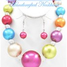 JONFRANCA CIAGA's fashion necklace with bold acrylic pearls in candy store colors.