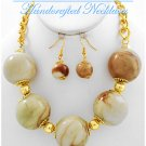 JONFRANCA CIAGA's Hampton Hills® fashion necklace with ceramic balls in a beige mix.