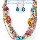 Multi strands of Zebra print with multi shades acrylic seeds and beads fashion necklace.