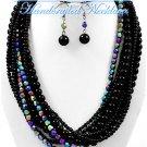 Multi strands of black Hampton Hills® acrylic balls by JONFRANCA CIAGA. Fashion necklaces.