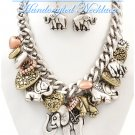 Bold chains with elephant and heart charms by JONFRANCA CIAGA. Fashion necklaces.