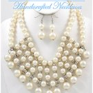 Rows of smooth creme faux pearls and bold chains by JONFRANCA CIAGA. Wholesale necklaces.