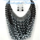 Rows of black/grey premium faux pearls and stones by JONFRANCA CIAGA. Wholesale necklaces.
