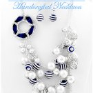Premium blue and white acrylic pearls with nautical sea life by JONFRANCA CIAGA fashion necklaces.
