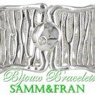 A lavish fun costume jewelry bracelet has crystal accents and elegant scroll design.