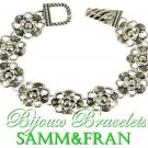 Boutique look, fashion bracelet of beautiful silvertone metalwork with a fabulous flower motif.