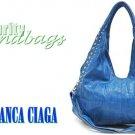 Fashion handbag. Blue studded hobo in Nantucket Bay vegan leather by JONFRANCA CIAGA .