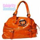 Divine!..Orange patent-leather celebrity handbag by AFFIRMATION on sale now.