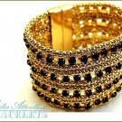 MEDIA ATTENTION fashion bracelet with blazing rhinestones and fantastic gold-tone detailing.