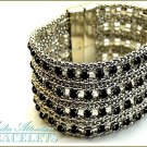 MEDIA ATTENTION fashion bracelet with black ice rhinestones and fantastic silver-tone detailing.