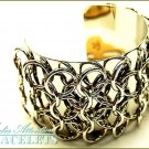 MEDIA ATTENTION cuff fashion bracelet with interlocking rings and fantastic silver-tone detailing.