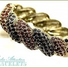 MEDIA ATTENTION boutique fashion bracelet, with colorful crystal studs and extravagant detailing.