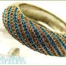 MEDIA ATTENTION fashion bracelet, with Paramount teal crystal stones and fine metalwork.