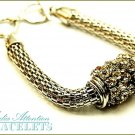 MEDIA ATTENTION fashion bracelet, with Paramount crystal stones and bright cable metalwork.