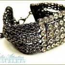 MEDIA ATTENTION boutique fashion bracelet, with Paramount crystal stones and cable metalwork.