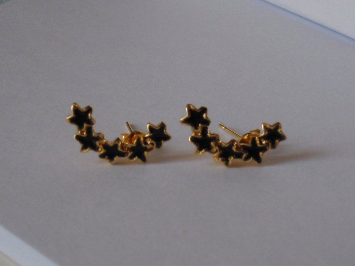 Black Star earrings with golden colour edge