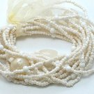 CREME CREAM NATURAL WHITE  MULTI STRAND LUCITE BEAD BALL RIBBON BRACELET