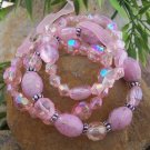 NEW PINK FACETED LUCITE MULTISTRAND BEAD BRACELET