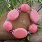 NEW PINK SALMON CERAMIC FACETED BEAD BRACELET
