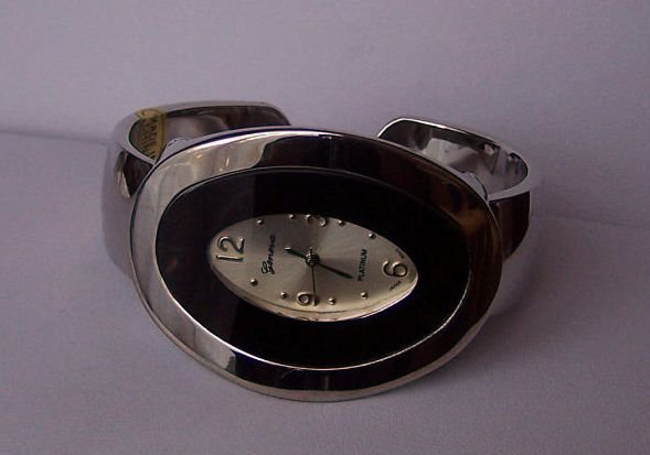 Black Oval Silver Tone Bangle Bracelet Watch