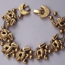 Gold Tone Alligator Crocodile Sliding Charm Bracelet