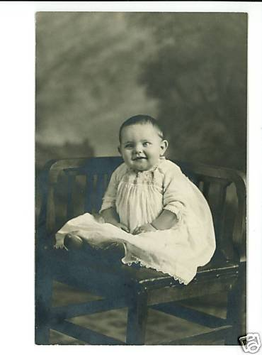 HAPPY BABY ON CORNER CHAIR REAL PHOTO POSTCARD ANTWERP