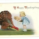 HAPPY THANKSGIVING GIRL FEEDING TURKEY POSTCARD 1915