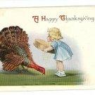 HAPPY THANKSGIVING GIRL FEEDING TURKEY POSTCARD 1915