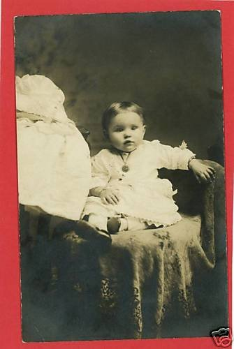 RPPC BABY ON FUR COVERED CHAIR WEARING NECKLACE  CUTE !